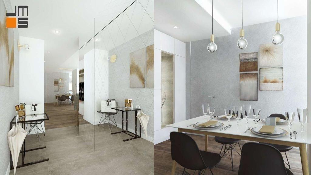 Szara, betonowa ściana z obrazami to idealne tło dla białego stołu jadalnianego i czarnych krzeseł