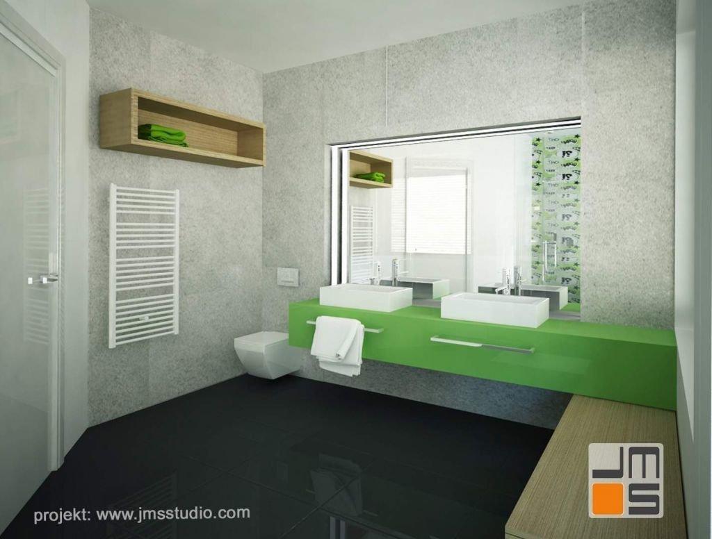 W pojekcie wnętrz łazienki zastosowano ciekawe rozwiązanie układu szafek fornirowanych i lakierowanych na zielony kolor w połysku