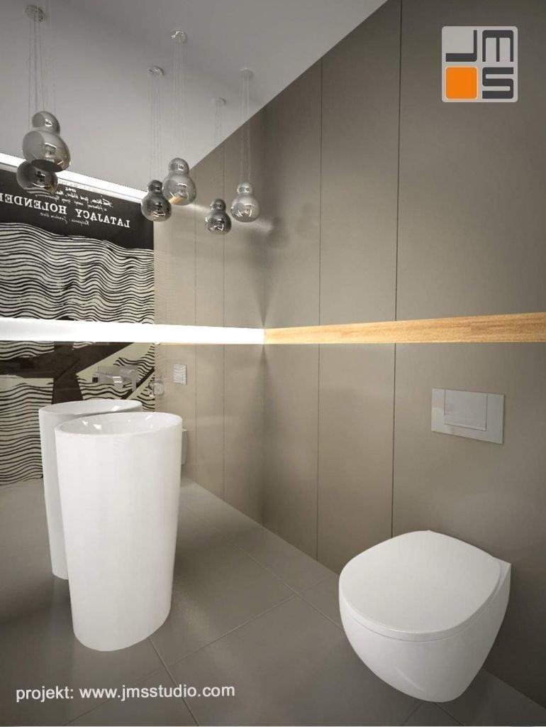 W projekcie ekskluzywnej łazienki z dużym plakatem zastosowano umywalkę wolnostojącą i stonowaną kolorystykę