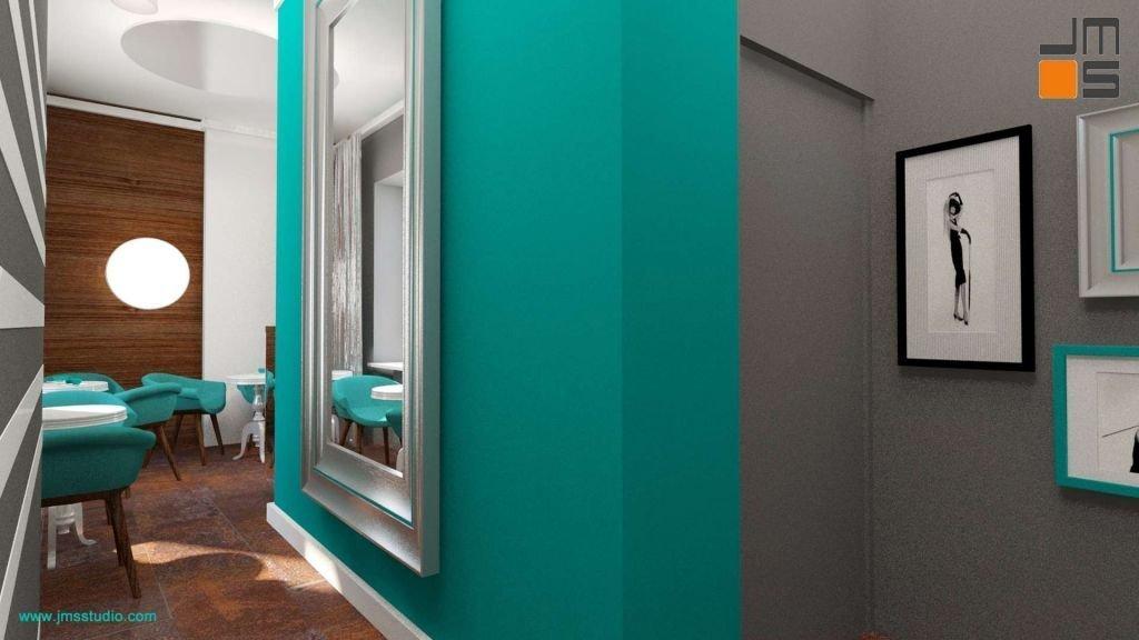 Grafiki i zdjęcia są dobrym pomysłem na zaaranżowanie ściany tak w kawiarni jak i w domu