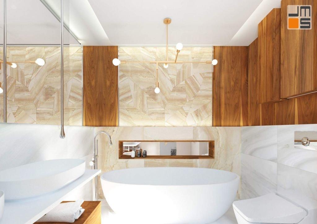 w łazience zastosowano baterię umywalkową z wyledwką sufitową oraz wannę wolnostojącą ze specjalną barteią wolnostojącą do niej dedykowaną