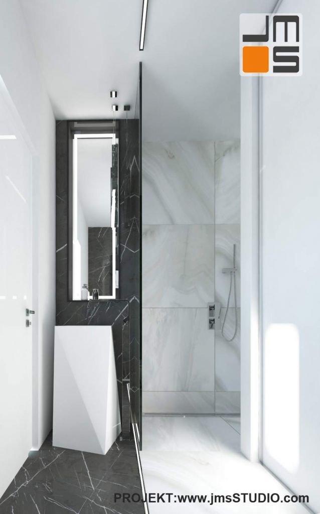 łazienka w apartamencie z nowoczesna asymetryczna umywalką i marmurem