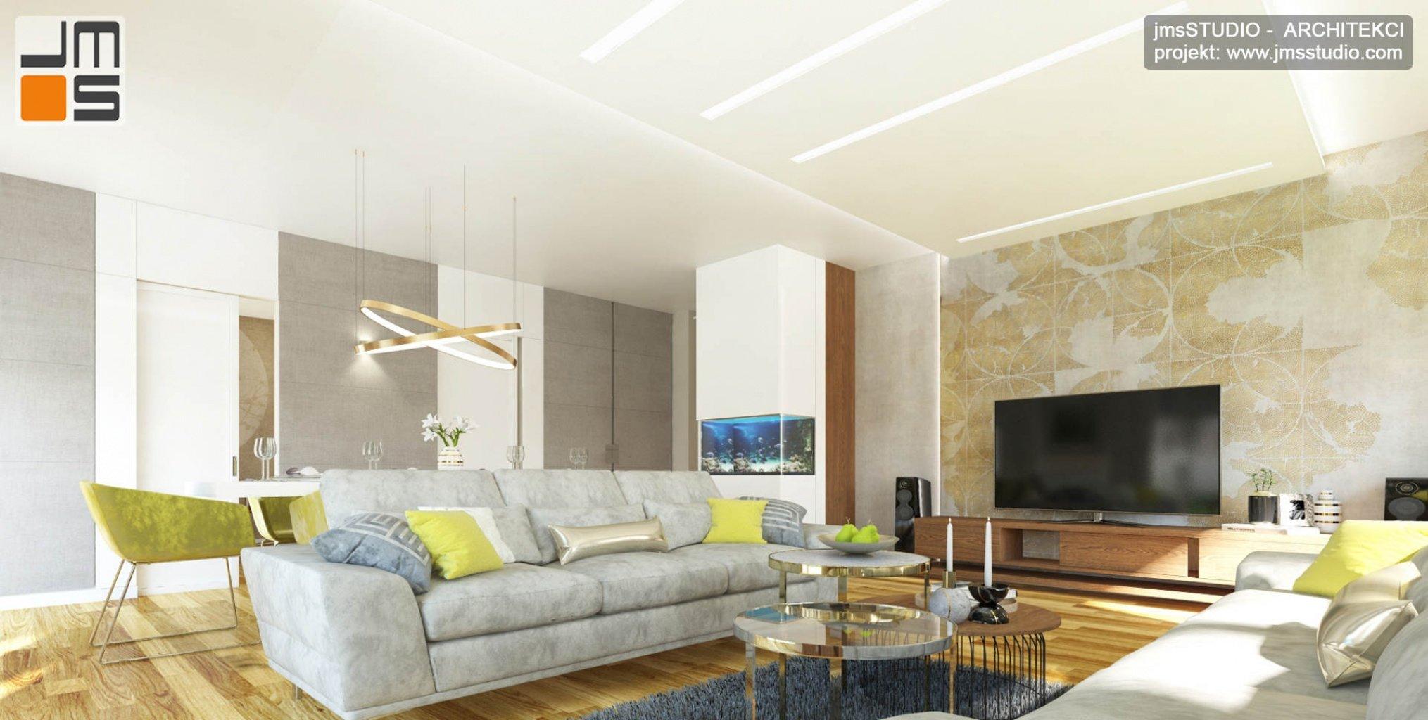 ekskluzywny projekt wnętrz eleganckiego mieszkania w Krakowie salon z dużą sofą i tapetą z wzorem