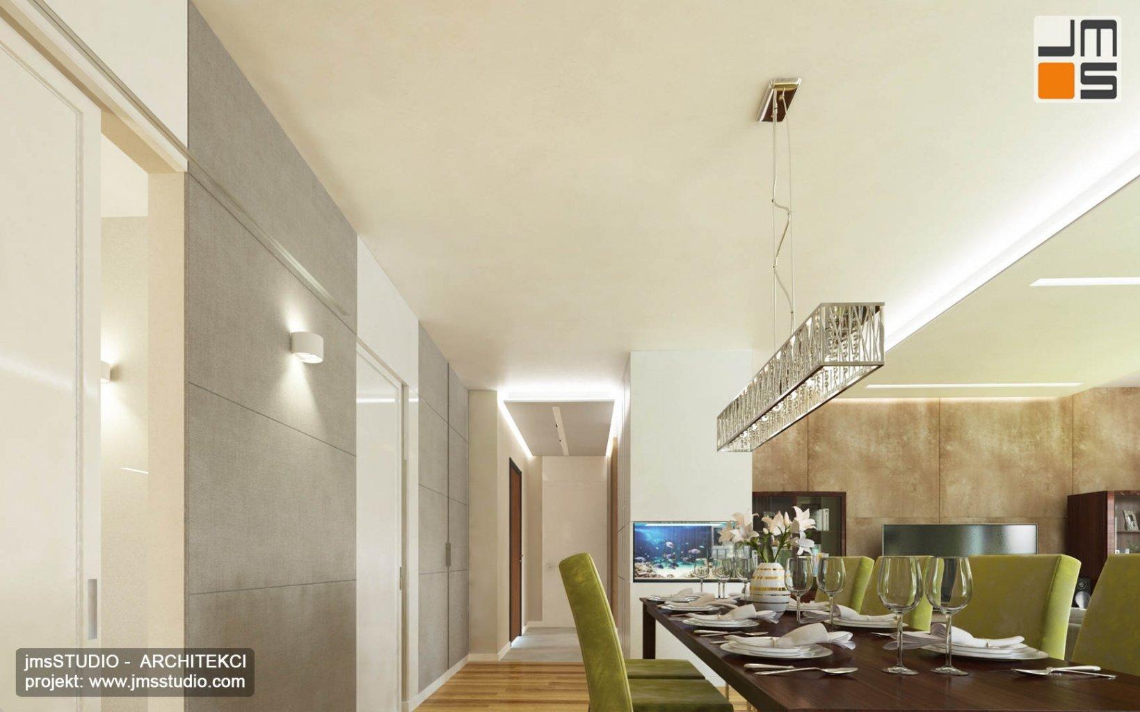 ekskluzywny projekt wnętrz eleganckiego mieszkania w Krakowie projekt jadalni z dużą lampą nad drewnianym stołem