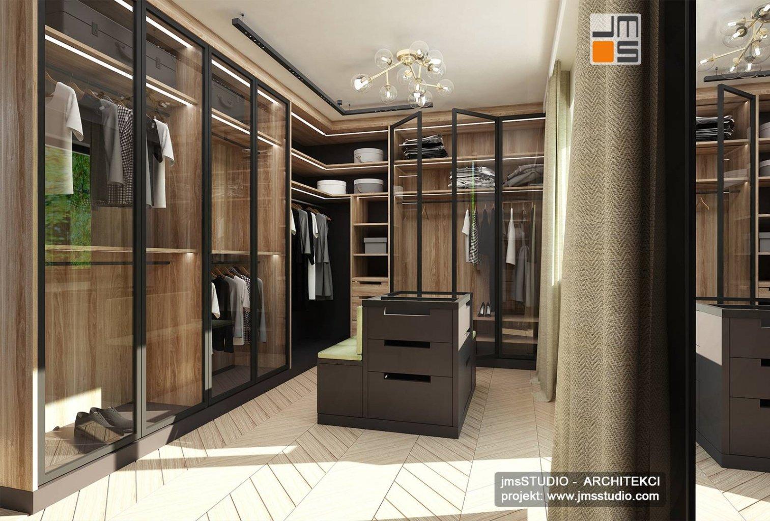 projekt wnętrz bardzo dużej garderoby z ekskluzywne meble orzech i szklane fronty w Katowicach