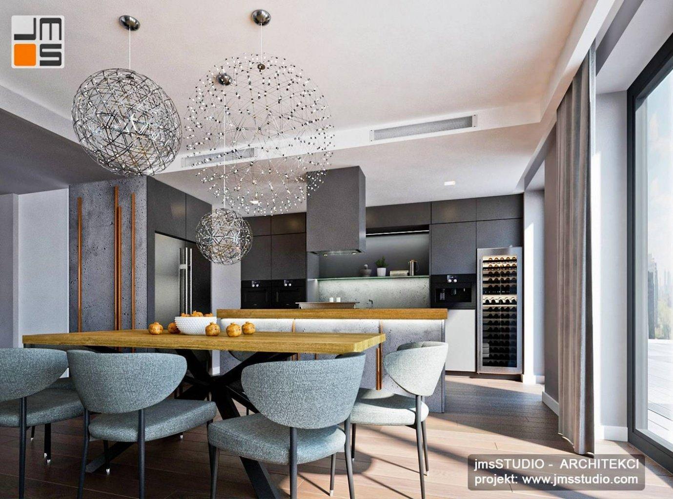 Projekt wnętrz luksusowej kuchni w kolorach szarości z miedź beton architektoniczny i jasne drewno w mieszkaniu Kraków
