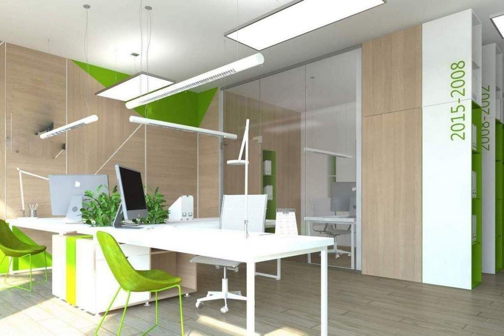 Projekt wnętrz nowoczesnego biura z szklane ściany działowe i  z grafika na ścianie w Krakowie