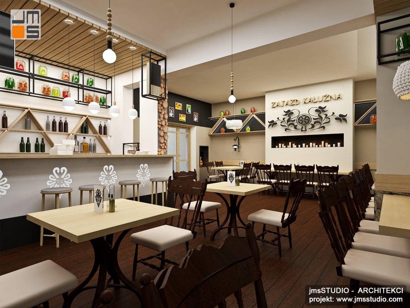 Kominek we wnętrzu restauracji góralskiej jako pomysł na projekt wnętrz przytulnych i nowoczesnych