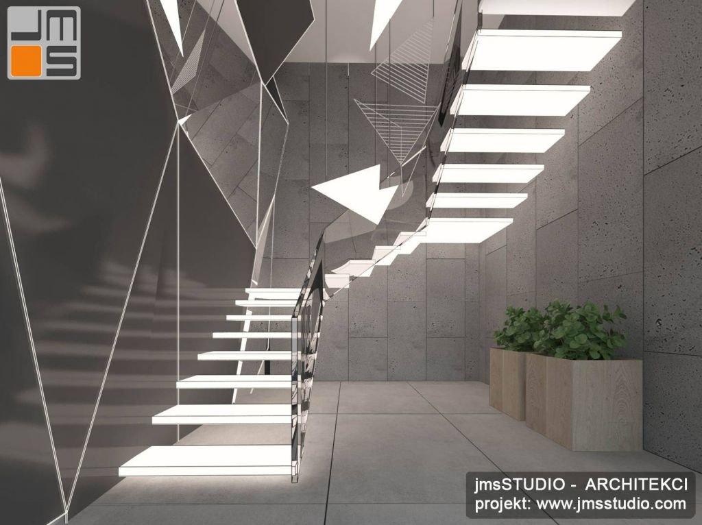 Projekt designerskich wnętrz klatki schodowej i schodów w dużym domu jednorodzinnym z betonem architektonicznym w projekcie wnętrza oraz stalowymi schodami