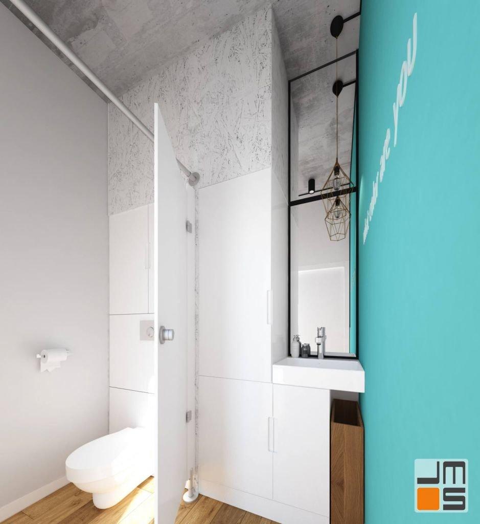 Elementy wnętrza zostały zaprojektowane z płyty osb malowanej na szaro zestawionej w projekcie wnętrz z szarym betonem architektonicznym na suficie studia paznokci w Wieliczce