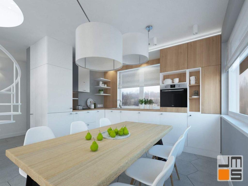 Projekt przewidywał zaprojektowanie wnętrza kuchni i salonu przy wykorzystaniu ciepłych odcieni Drewna ,szarości ,bieli