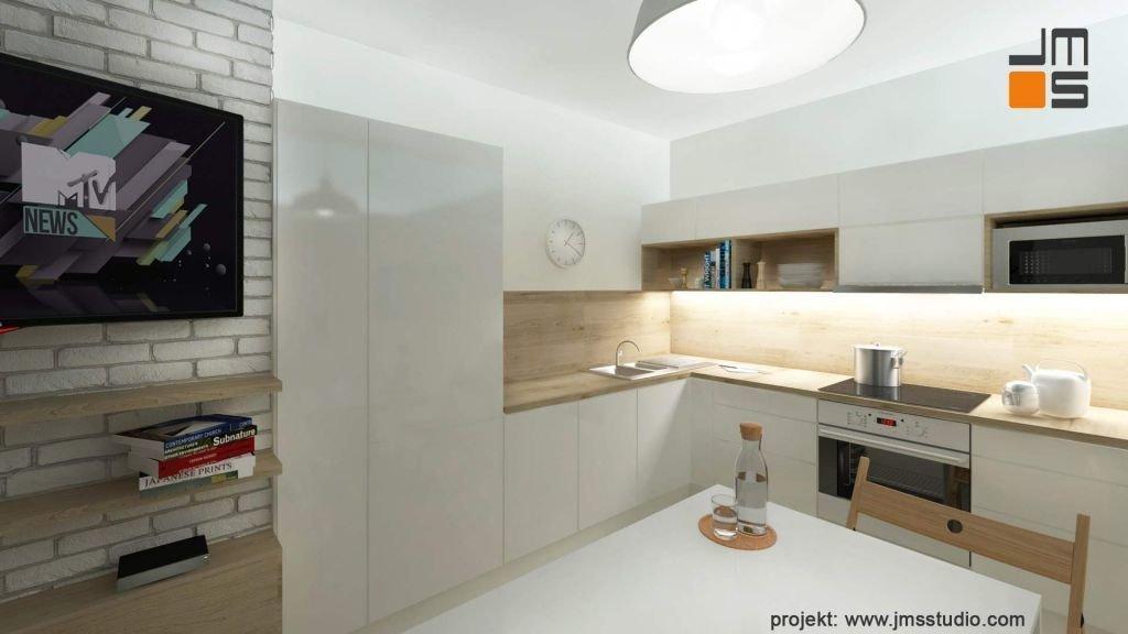 Projekt wnętrz nowoczesnej kuchi w jasnych kolorach z drewnianym blatem roboczym i lakierowanymi frontami szafek w Bielsku