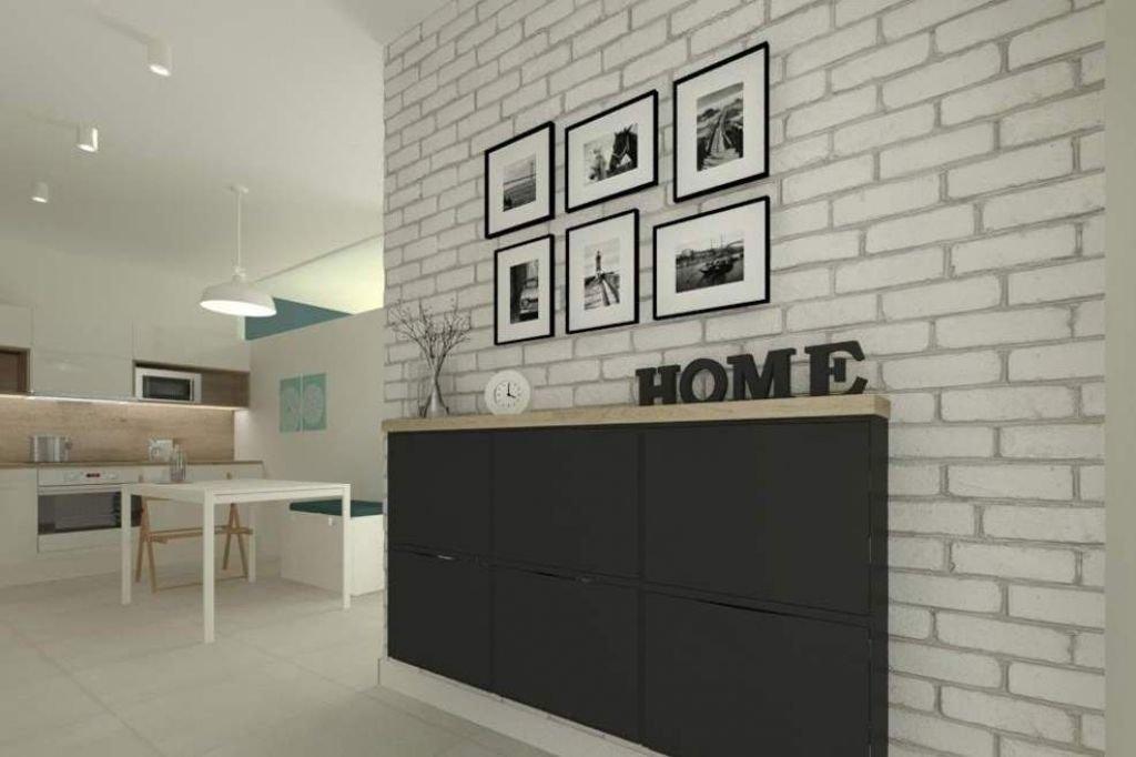 Ciekawy minimalistyczny tani w realizacji projekt wnętrz małego mieszkania w Bielsku Białej z cegłą na ścianie