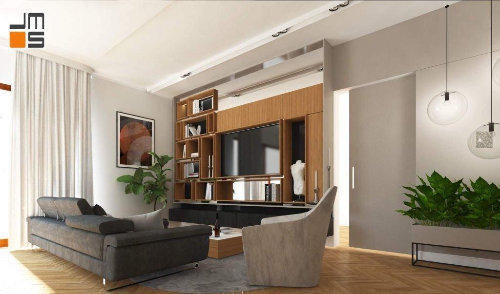 Ciekawy pomysł na ścianę z telewizorem i ukryte drzwi w apartamencie w Krakowie