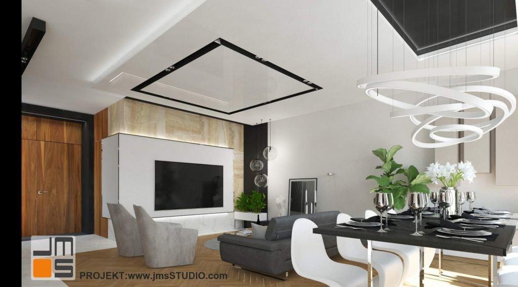 Ciekawym pomysłem w projekcie wnetrz był duży telewizor wieszany na ścianie