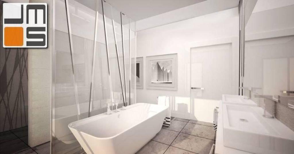 Aranżacja łazienki z wanną wolnostojącą i białymi płytkami