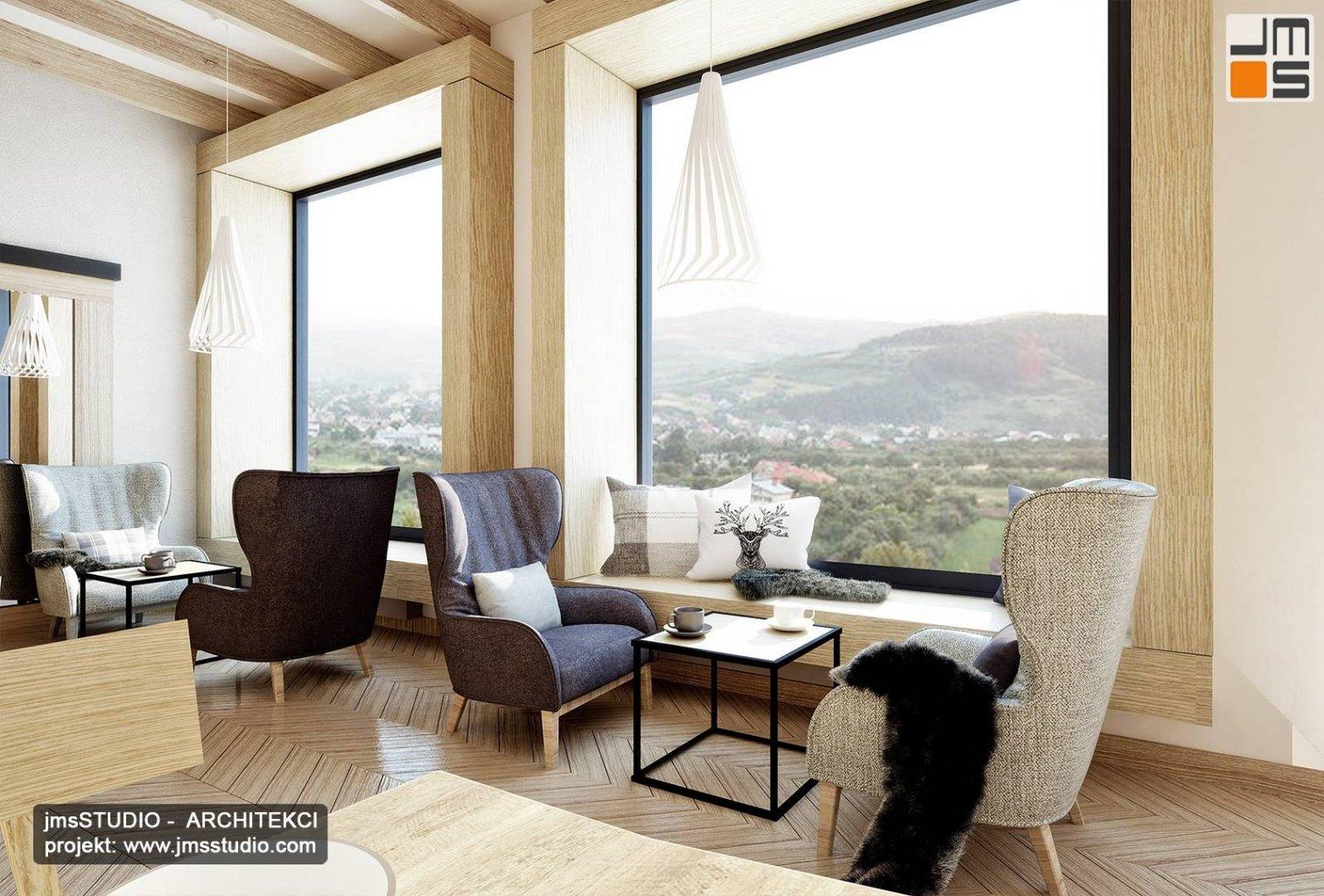 projekt wnętrz restauracji regionalnej z parapet do siedzenia i drewniane dekoracyjne ramy okienne