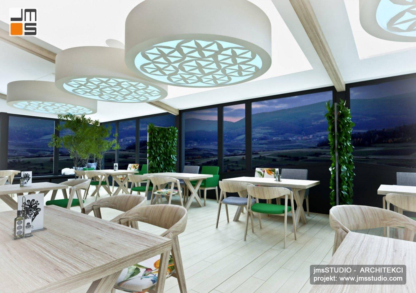 duże efektowne lampy LED RGB we wnętrzu restauracji dają nastrojowe oświetlenie restauracji z dekoracjami regionalnymi w projekcie wnętrz