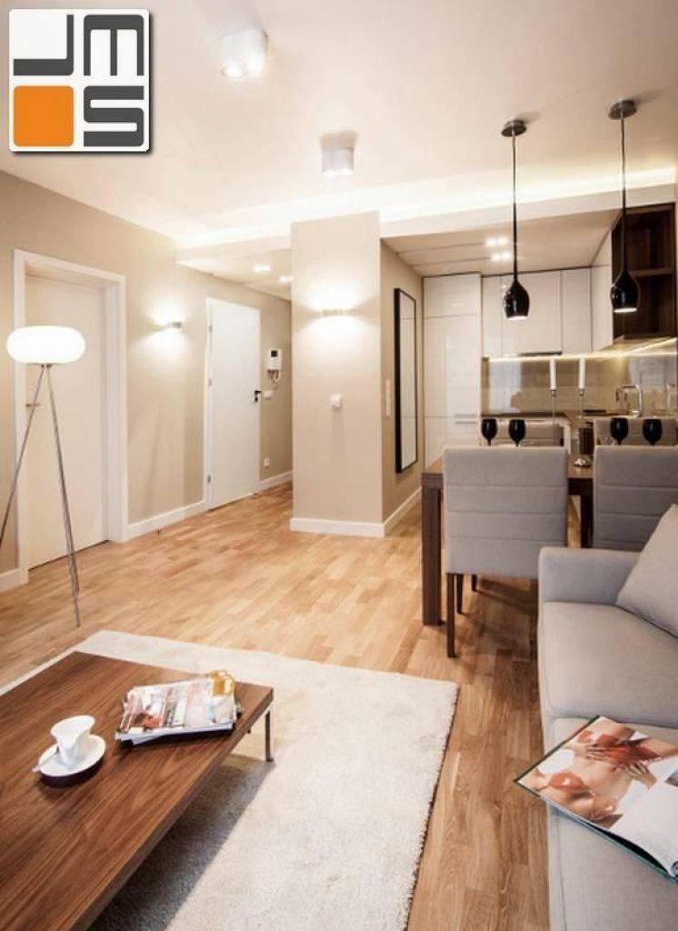 Nowoczesne oświetlenie salonu z aneksem kuchennym w niewielkim apartamancie