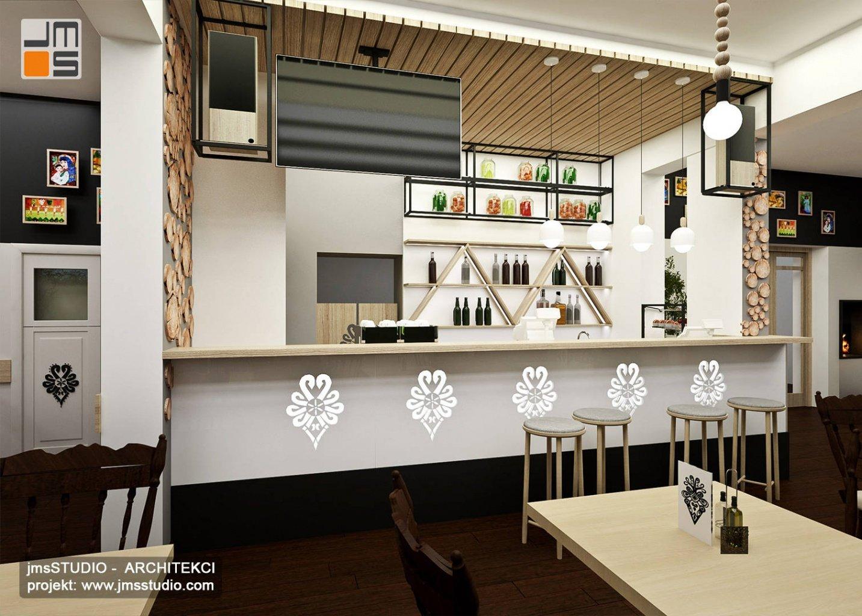Projekt wnętrz restauracji Kraków z designerskim nowoczesnym barem z dekoracyjnymi wzorami z podświetleniem