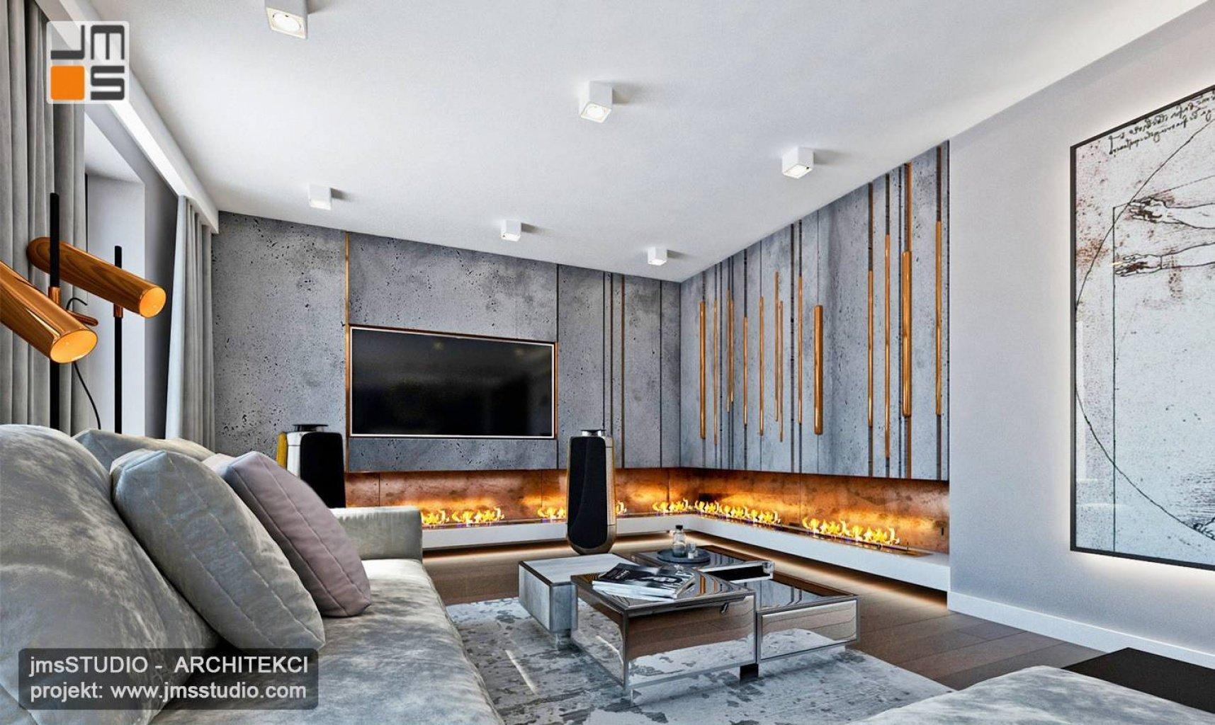 Projekt wnętrz salonu z kominkiem Planica betonem architektonicznym i dekoracjami z miedź we wnętrzu mieszkania w Kraków