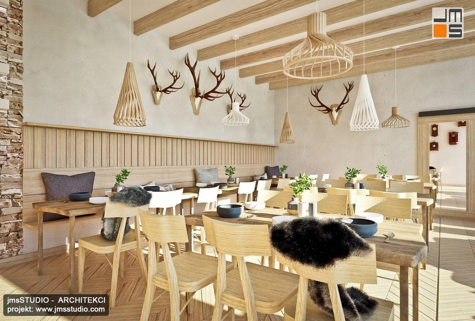 proste drewniane meble dekoracyjne drewniane lampy i kamień łupek to projekt wnętrz restauracji w Pieninach
