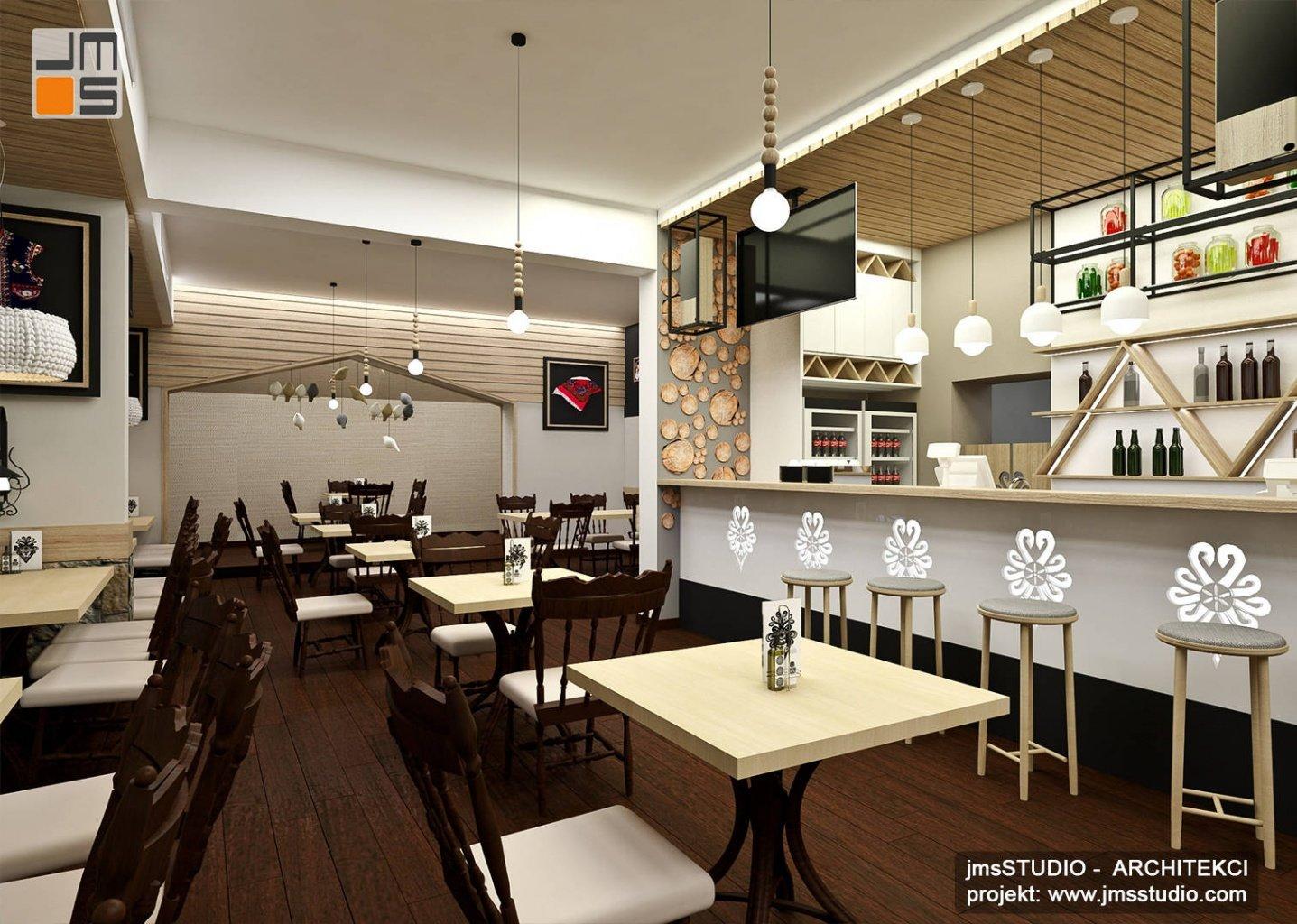 oryginalny projekt wnętrz restauracji z drewnem i dekoracyjnym oświetleniem. Projekt restauracji w górach z barem w stylu tradycyjnym nowoczesnym