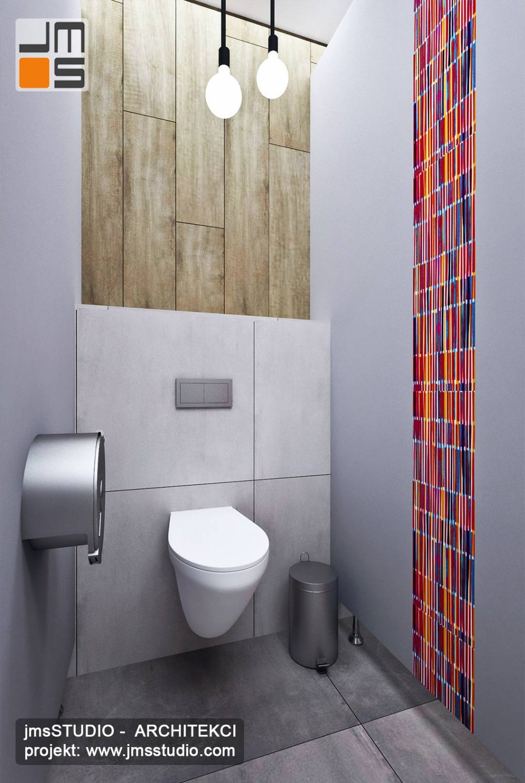 Ciekawa grafika na ścianie w toalecie w restauracji to pomysł na projekt wnętrz