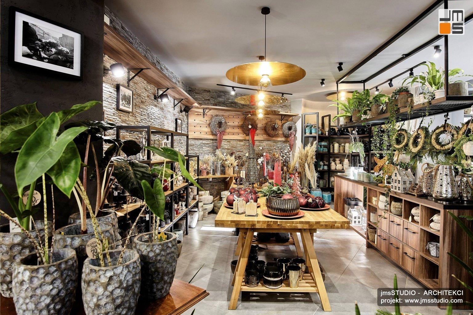 Projekt  wnętrz nowoczesnej kwiaciarni w Krakowie to pomysł na ekskluzywne wnętrze z elementami industrialnymi jak stalowe meble i lampy techniczne